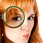 A woman looking through a magnifying glass. Finding something.