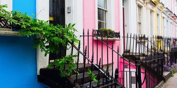A photograph of brightly coloured terraced houses in Notting Hill, London