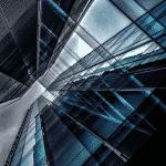 An upward-taken photograph of a glass skyscraper, commercial property