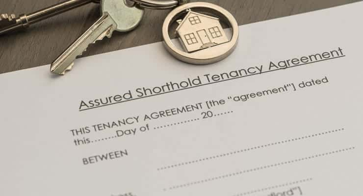 a keyring sits on an assured shorthold tenancy agreement