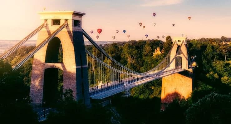 A hot air balloon race over Clifton Suspension Bridge in Bristol at sunset