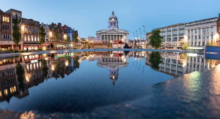 Old Market Square in Nottingham reflected in a pool at sunset