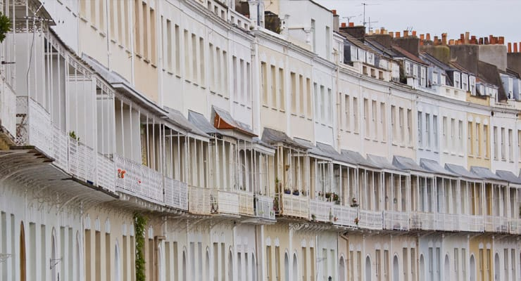 A curving row of white townhouses on Royal York Cresent in Clifton, Bristol