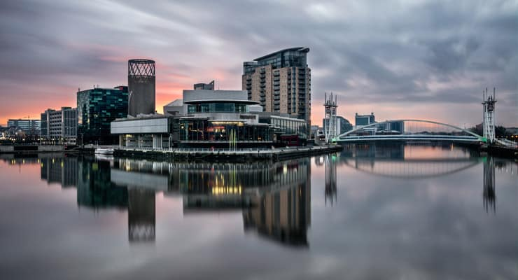 A long exposure photograph of Salford Quays at sunset