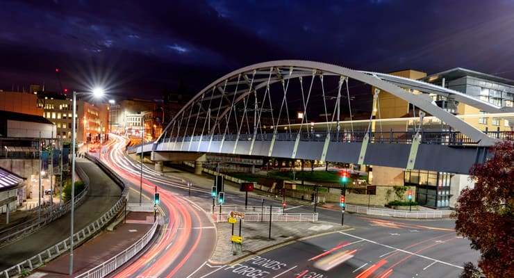 A nighttime photograph of Supertram Bridge in Sheffield. Officially called Park Square Bridge