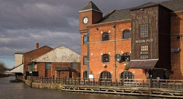 A photograph of Wigan Pier and restored warehouses alongside the Leeds Liverpool canal