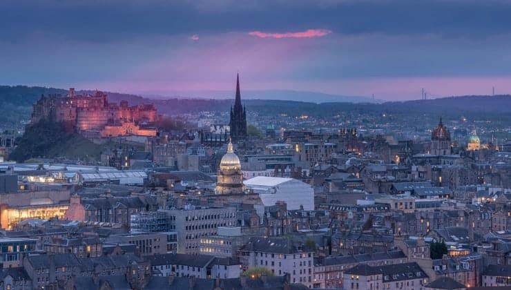 A photograph of the Edinburgh skyline at night