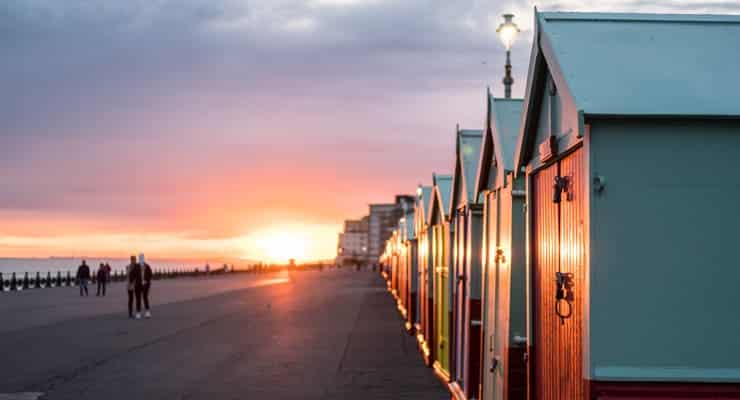 Colourful beech huts at sunset, Brighton and Hove