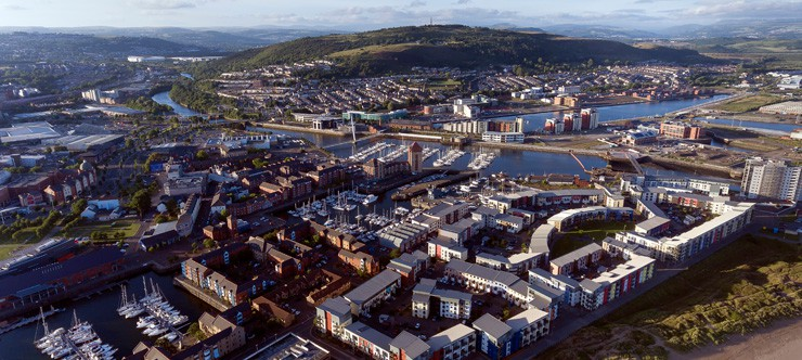 Aerial photograph of a new development around the Prince of Wales Dock, Swansea