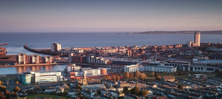 A view of Swansea city centre at sunset from Townhill.