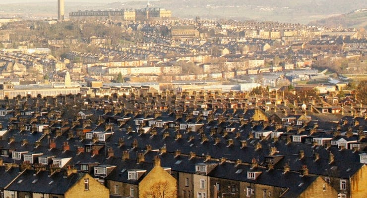 An areal photograph of the the industrial landscape of Bradford. Image shows terraced housing.