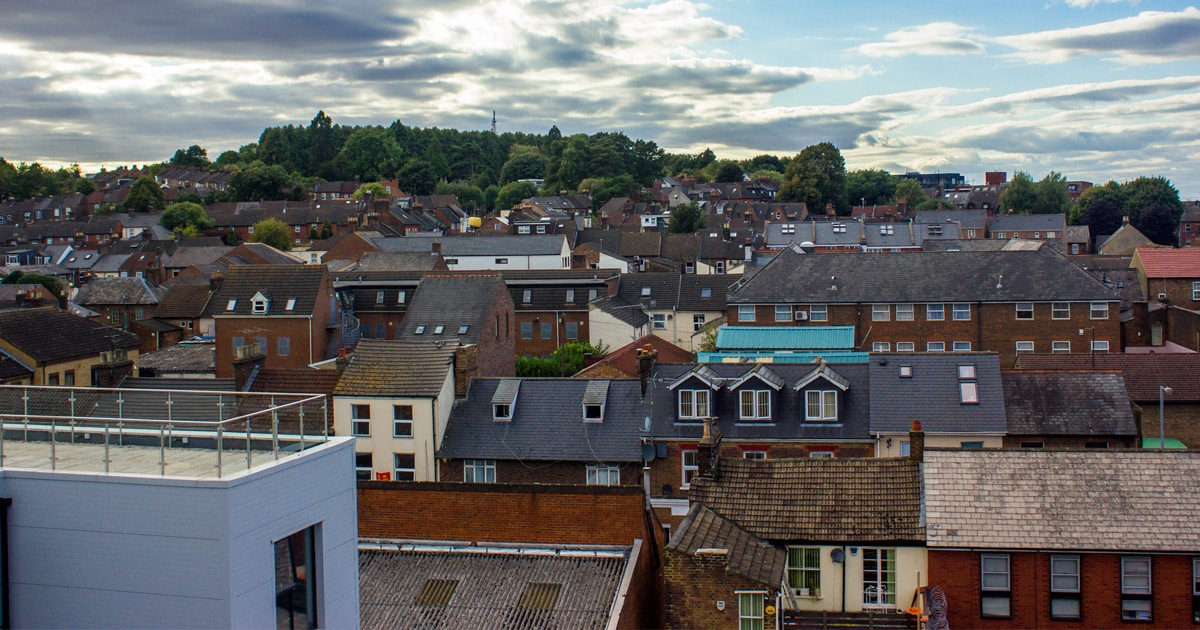 A slightly raised photograph of the rooftops of Luton, UK