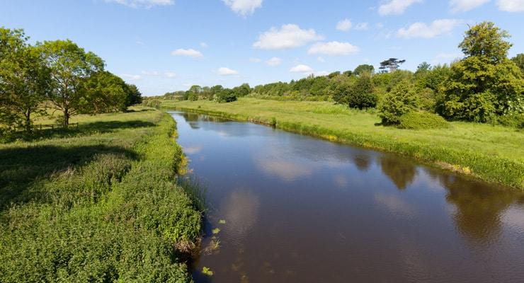 Serene long shot of the River Nene on a summer dat