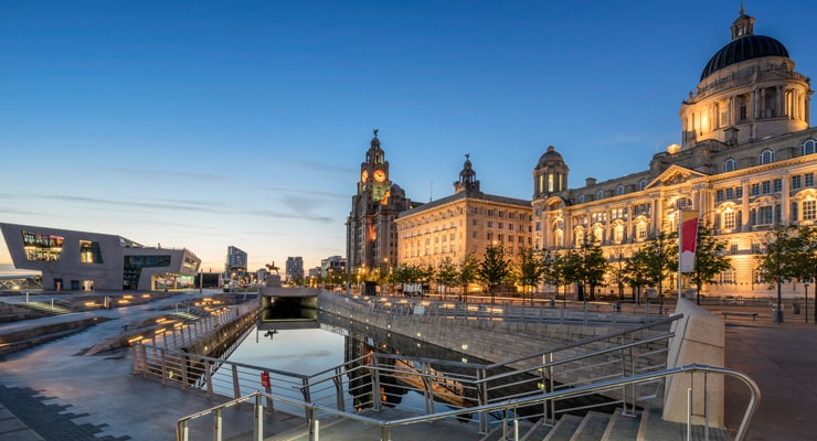 The Three Graces on Liverpool's Pier Head watefront. Photograph taken at sunset.