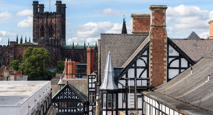 A raised image showing the rooftops of Victoria 'black and white revival movement' buildings with Chester Cathedral in the background.