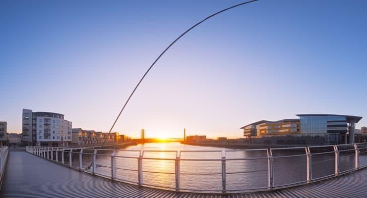 Panoramic photograph of the Millennium Footbridge at sunset. Newport, Wales.