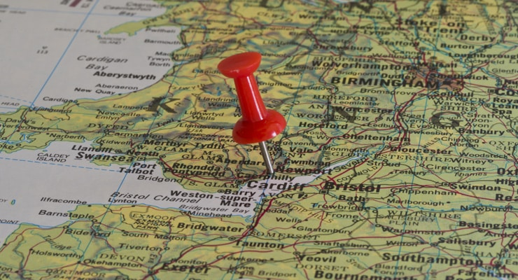 A red pushpin on a map of the UK. Pin pushed into Newport