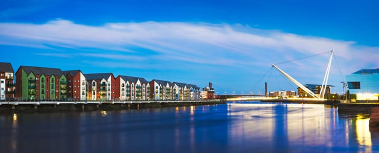 Newport's riverfront along the river Usk with the Millennium footbridge in the background