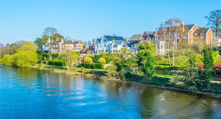 Residential houses next to the River Dee in Chester on a summer day