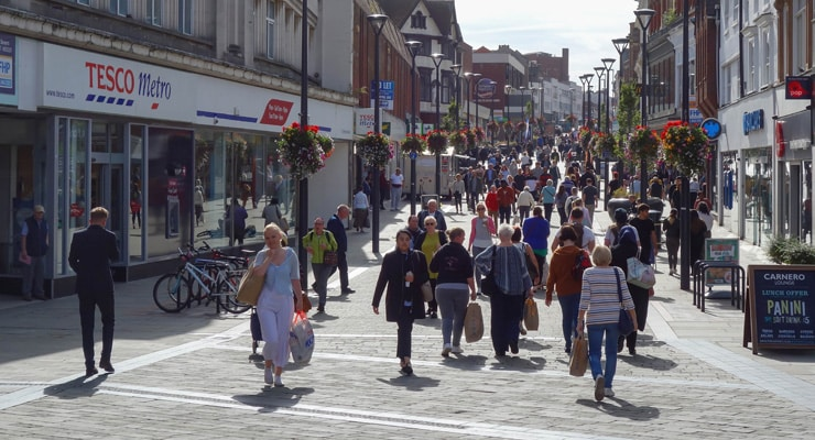 A busy pedestrianised shopping street (St. Peters Street, Derby, UK)