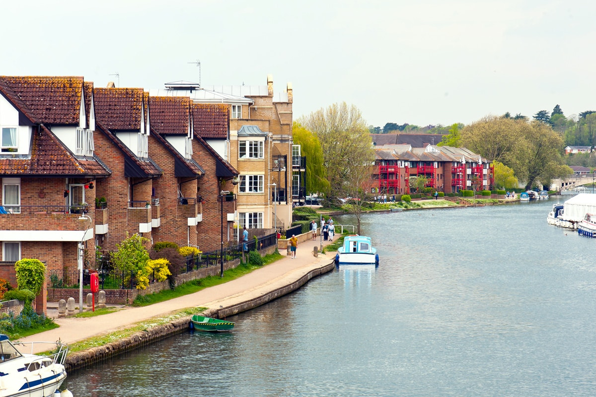 Slightly raised photograph of houses on the bank of the River Thames in Reading, UK