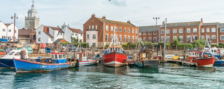 Old fishing boats docked in Portsmouth