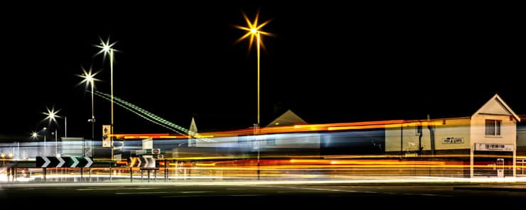 Light trails created by a long exposure at night. Photograph of the Magic Roundabout in Swindon