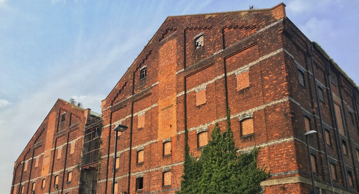 The side of an disused industrial building on Gloucester Quays