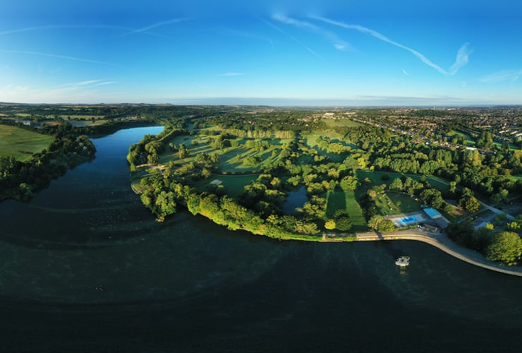 An aerial photograph of the water and countryside of Coate Water Country Park near Swindon