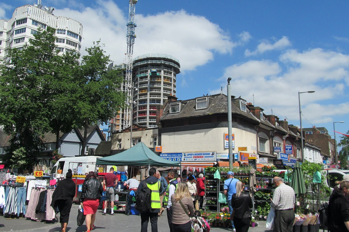 People shopping at the market, in Barking town centre, east London