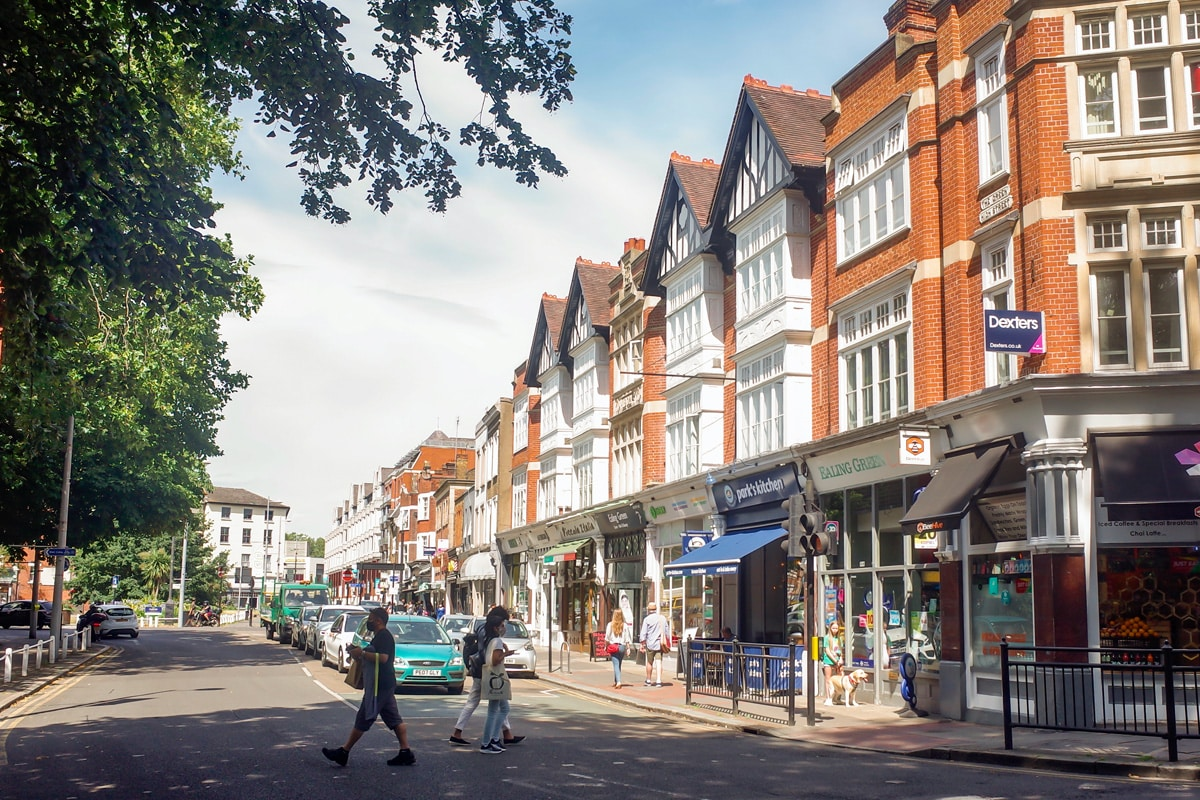 Ealing high street shops on a sunny day, an attractive residential area of West London.