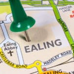 A pin stuck in a map of London in the district of Ealing