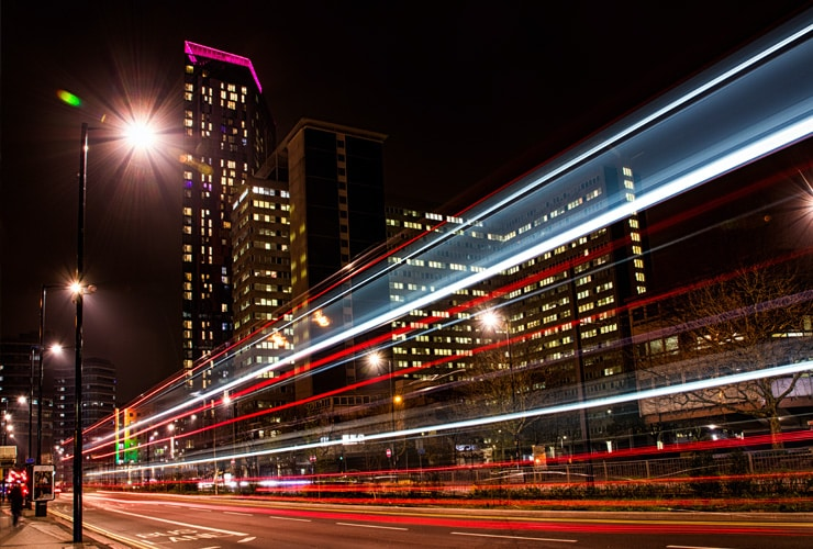 Long exposure light trails from a bus. Photograph taken in front of the Saffron Tower in Croydon
