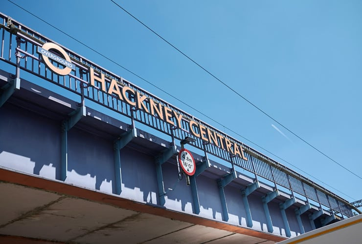 A railway bridge with the words, Hackney Central citing next to the Transport for London logo. This is the Hackney central overground sign.