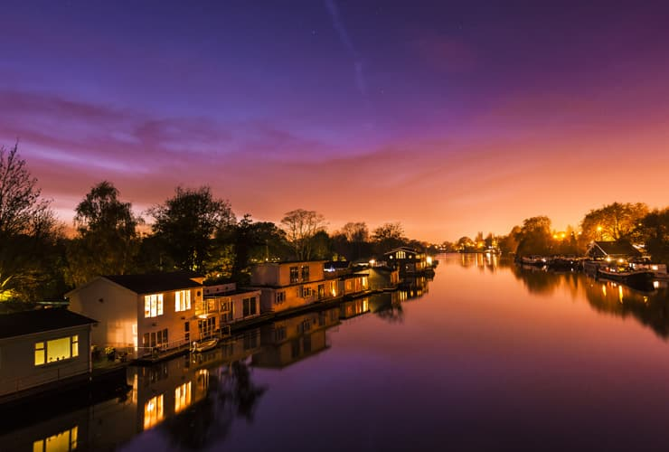 Flating houses on the Thames river at sunset. Photograph taken at Kingston-upon-Thames.