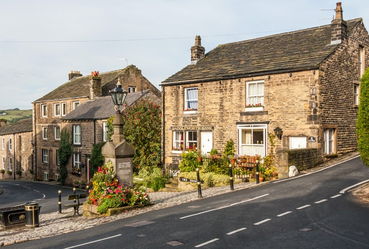 Old stone houses in the square in Dobcross, Oldham. One house was formerly the Saddleworth Bank.