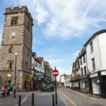 View of the clock tower and street in the centre of St Albans.