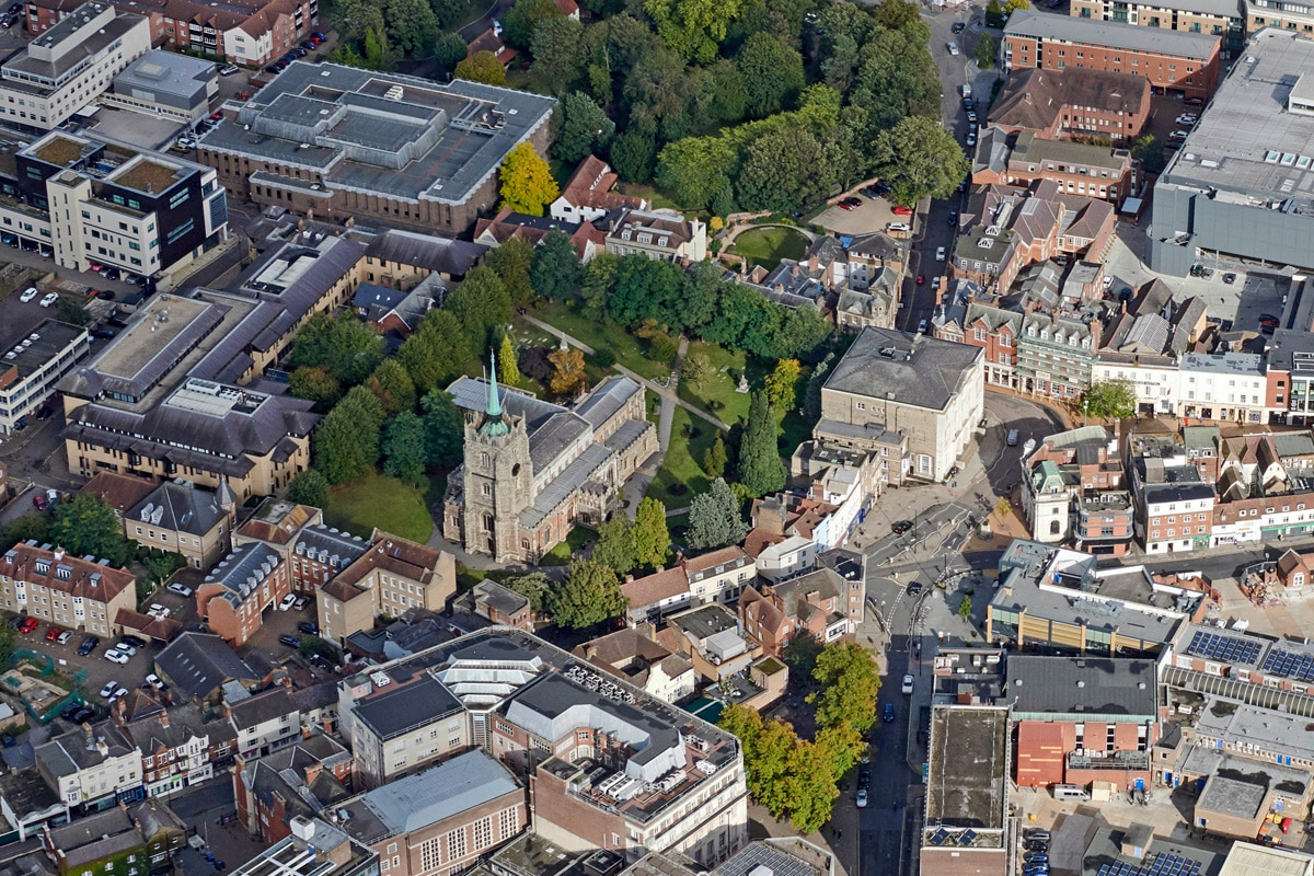 An aerial view of Chelmsford which includes Chelmsford Cathedral and Shire Hall.
