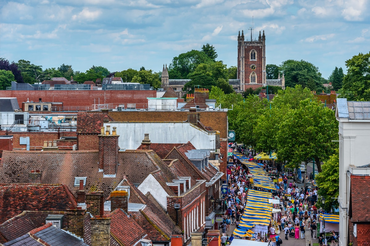 St Peter's Street and St Peter's Church seen from the Clock Tower on a market day. St. Albans, Hertfordshire, England.