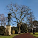 A small clocktower and a leafless tree in West Park, Wolverhampton.