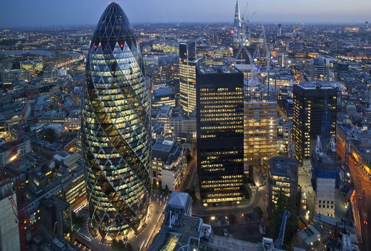 Aerial view of the City of London skyline at sunset.