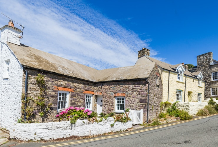 Old, colourful, stone cottages in St Davids, Wales.