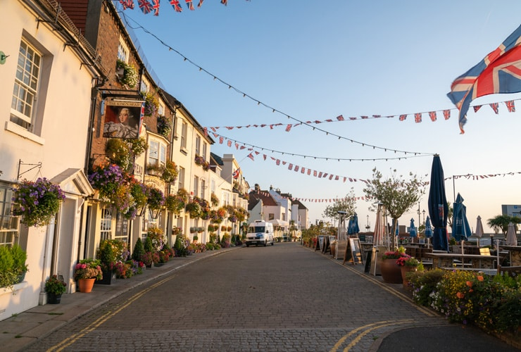 A beachfront in Deal with pubs, restaurants and bunting.
