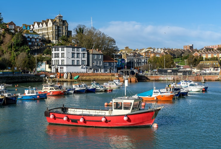Boats floating on the harbour at Folkestone, Kent.