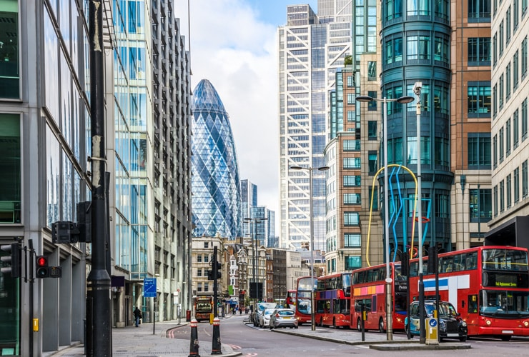Liverpool Street - A busy street in the centre of London with the Gherkin in the background.