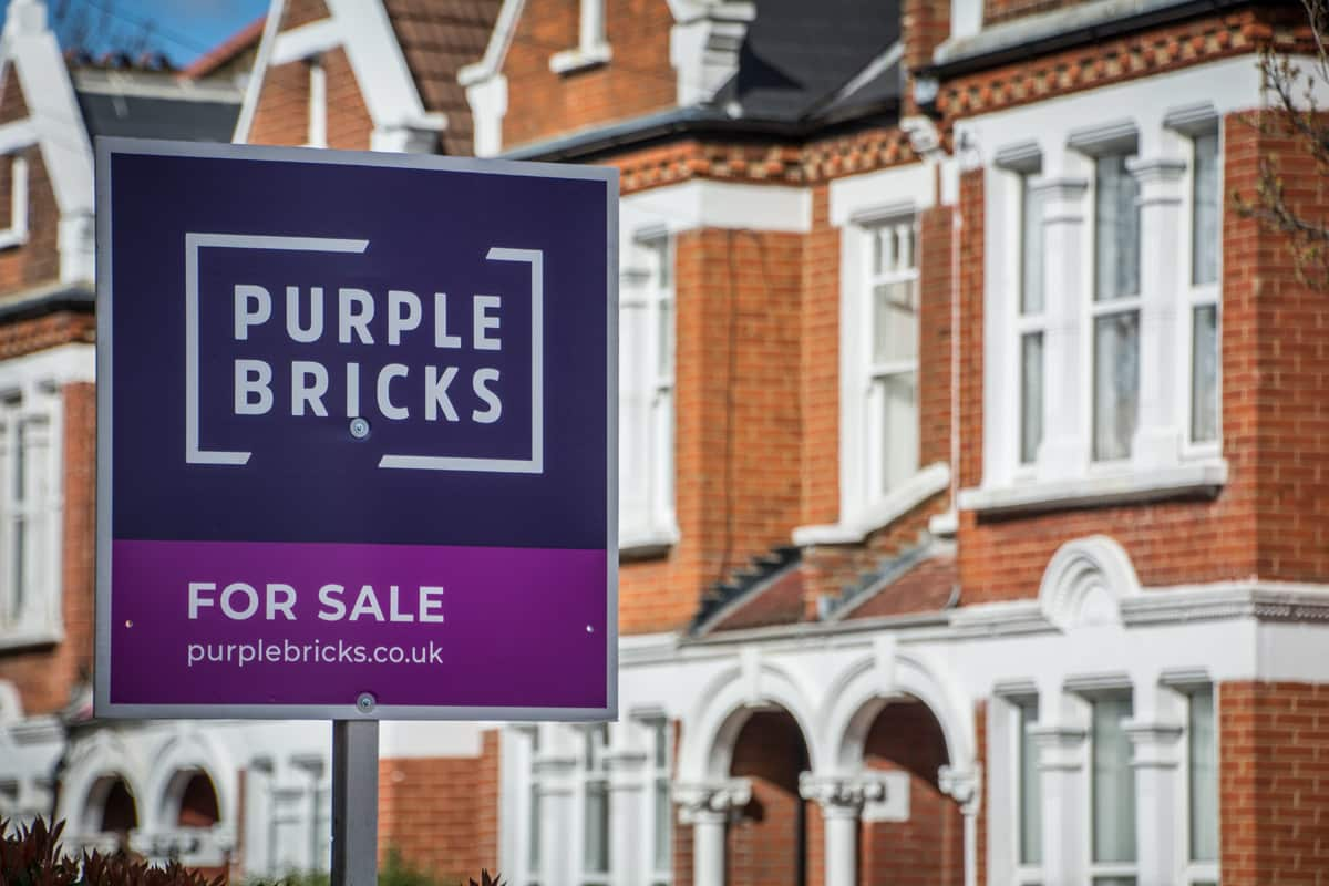 A Purple Bricks branded for say sign in front of a Georgian house.