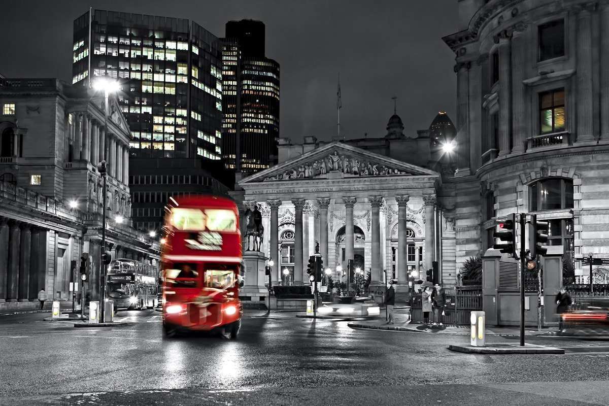 The Royal Exchange London. A red route master bus, in front of the Bank of England.