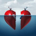 Concept for divorce. Two halves of a broken heart float in the ocean.