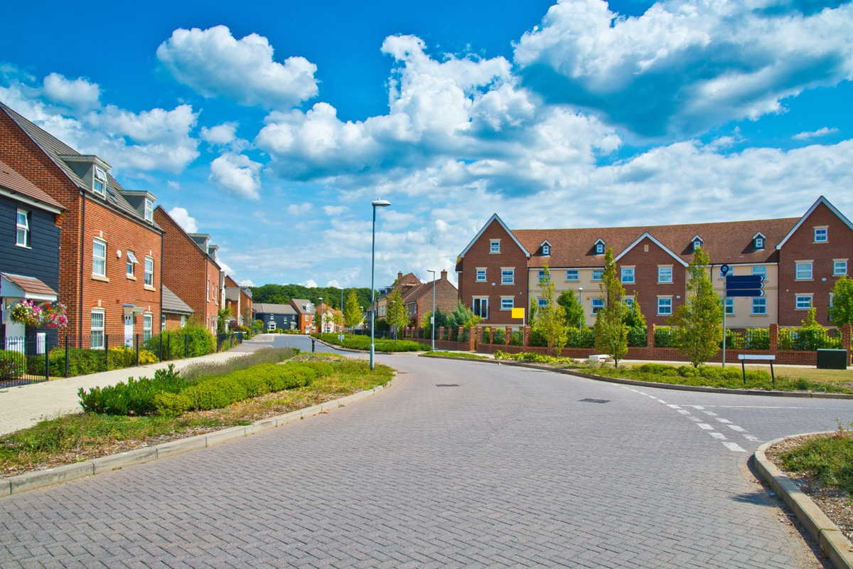 A new-build English housing estate on a bright summer's day.