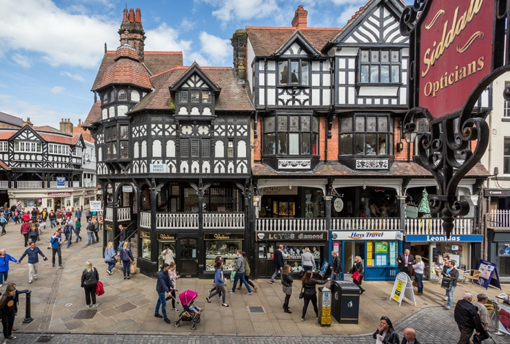 Black and white timber-framed buildings in Chester's city centre.